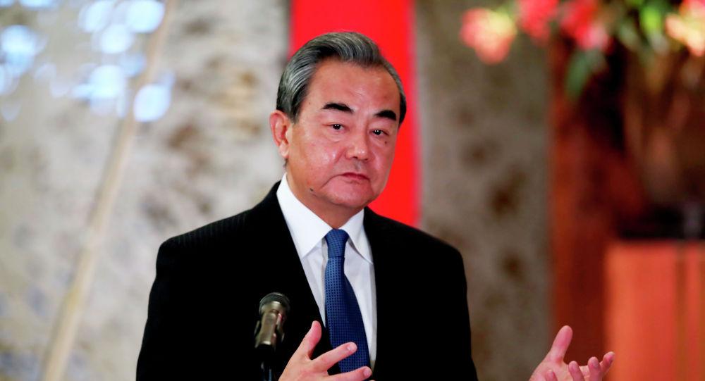 中韩外长通话 王毅:及早控制和减少不必要人员跨境流动至关重要