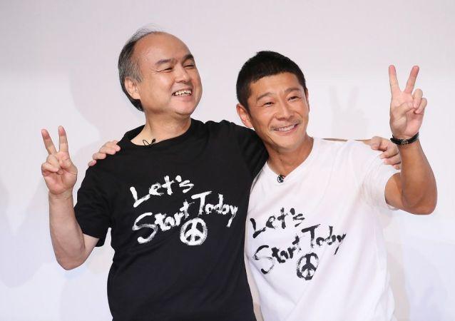 日本亿万富翁前泽友作(右边)