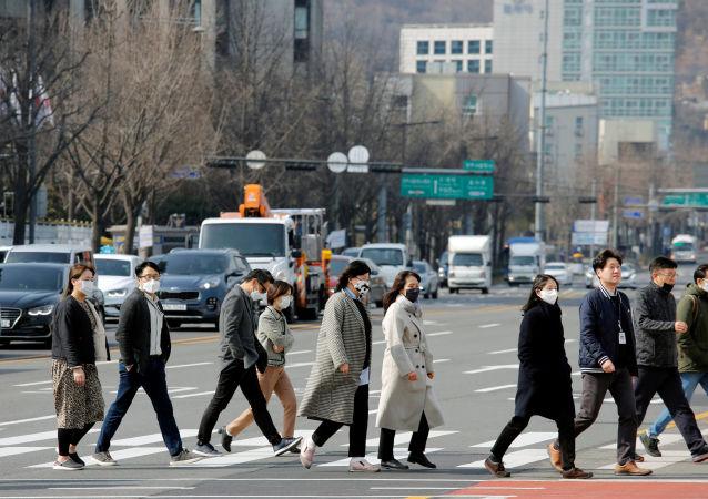 韩国自2月15日起下调全国保持社交距离措施级别 为期2周