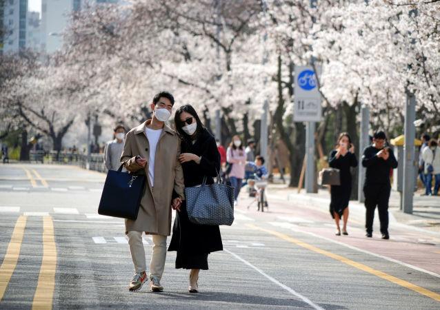 防护抗击COVID:为什么韩国人不用布口罩