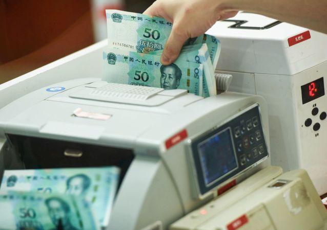 目前数字人民币研发工作只是试点测试 正式推出尚没有时间表
